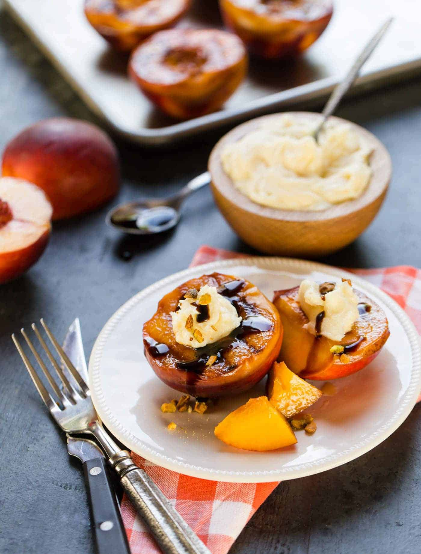 Grilled peaches with mascarpone cheese, pistachos, and balsamic glaze