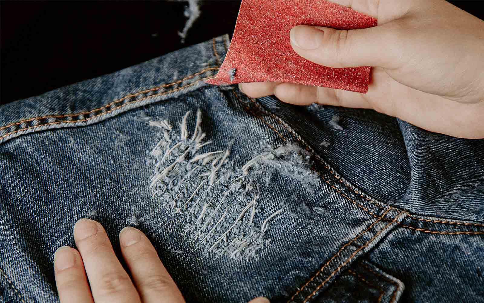Sandpaper distressed denim jacket