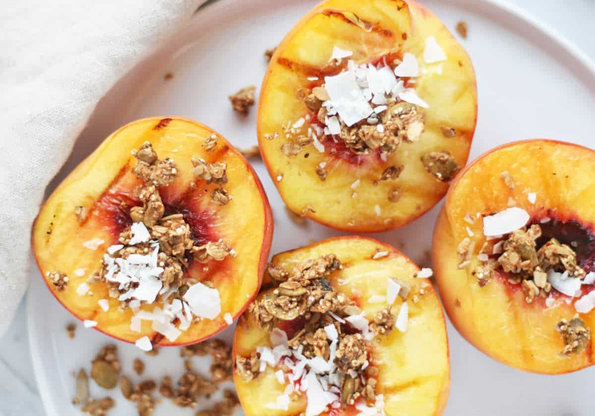 Smoky-sweet pecan stuffed grilled peaches