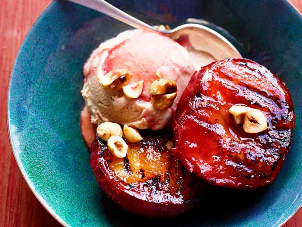 Warm plums with gelato