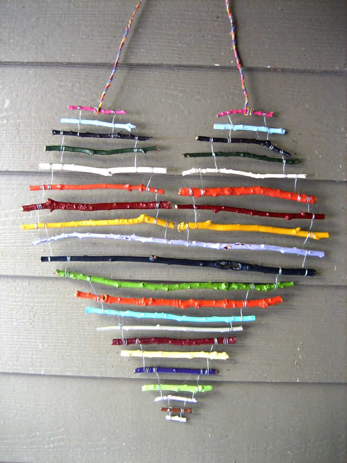 Horizontal painted twig heart mobile