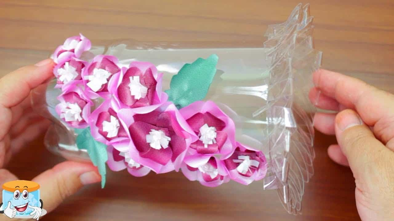 Plastic bottle and curled ribbon flower vase