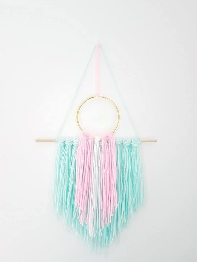 Pretty pastel wall hanging 15 Creative Yarn Projects that Look Awesome