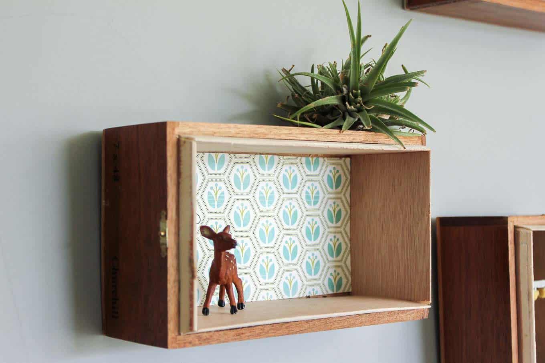 Wall mounted cigar box shelves