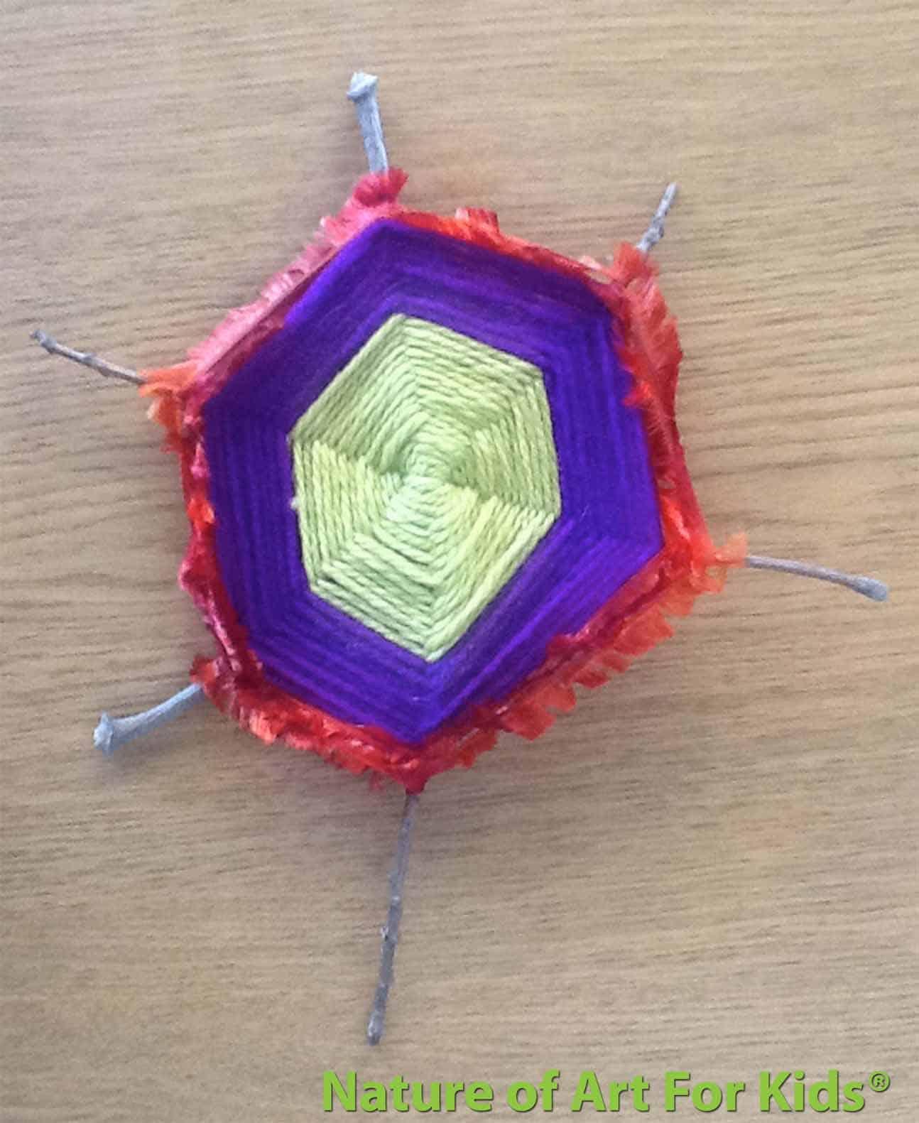 Yarn weaving on a twig frame
