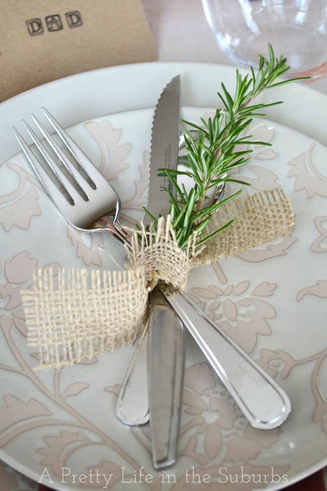 A simple knotted burlap and rosemary setting 15 DIY Thanksgiving Tablescapes and Place Settings