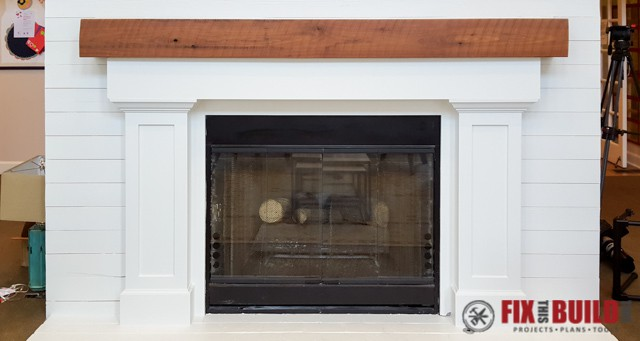 DIY fireplace surround with wooden mantel
