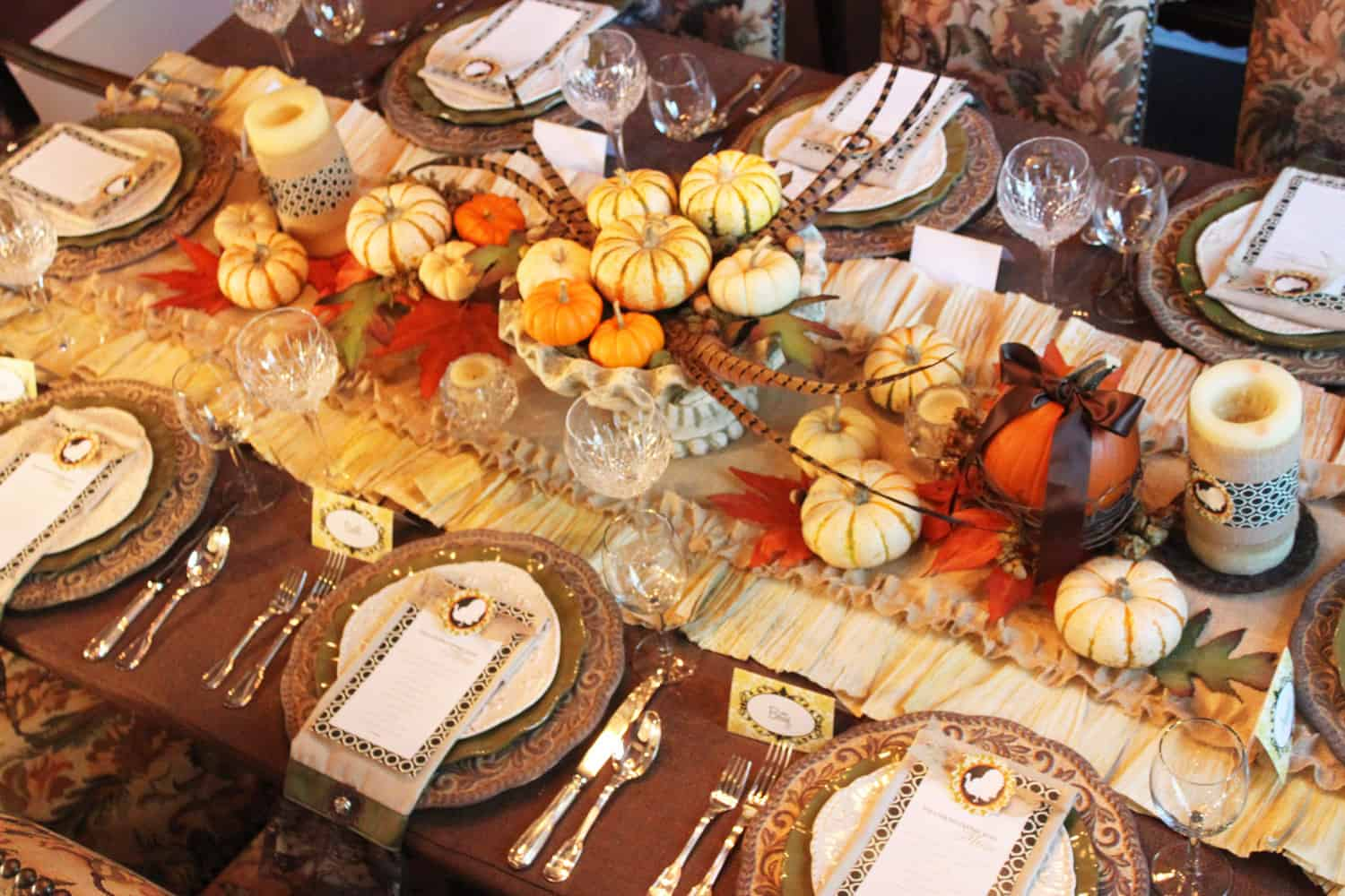 Ruched fabric and mini pumpkins tablescape