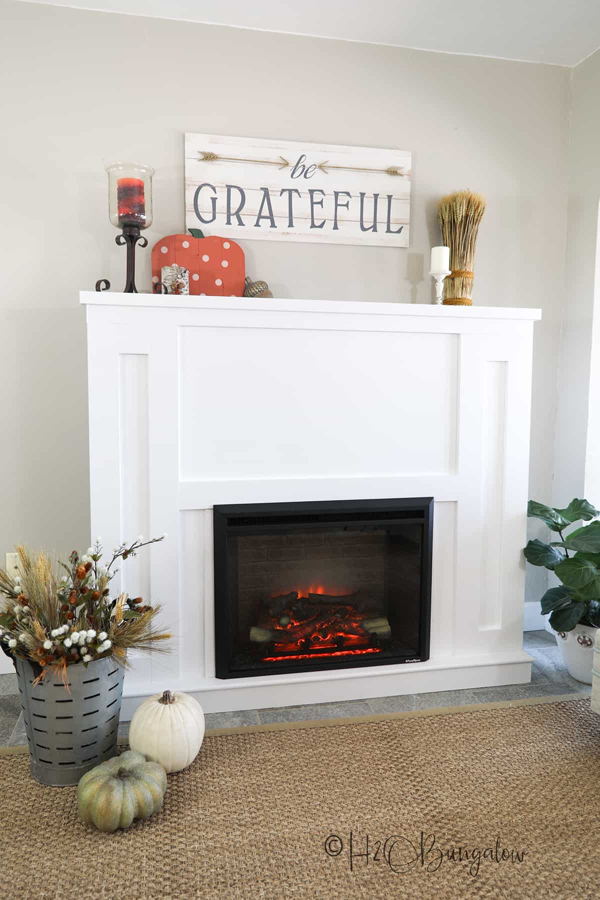 Simple DIY fireplace surround with electrical fire insert