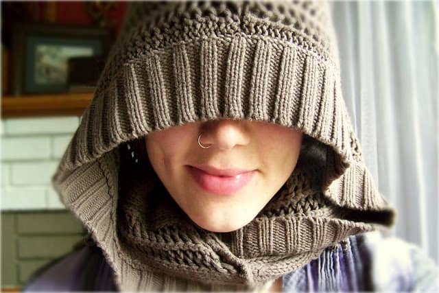 Sweater turned hooded scarf