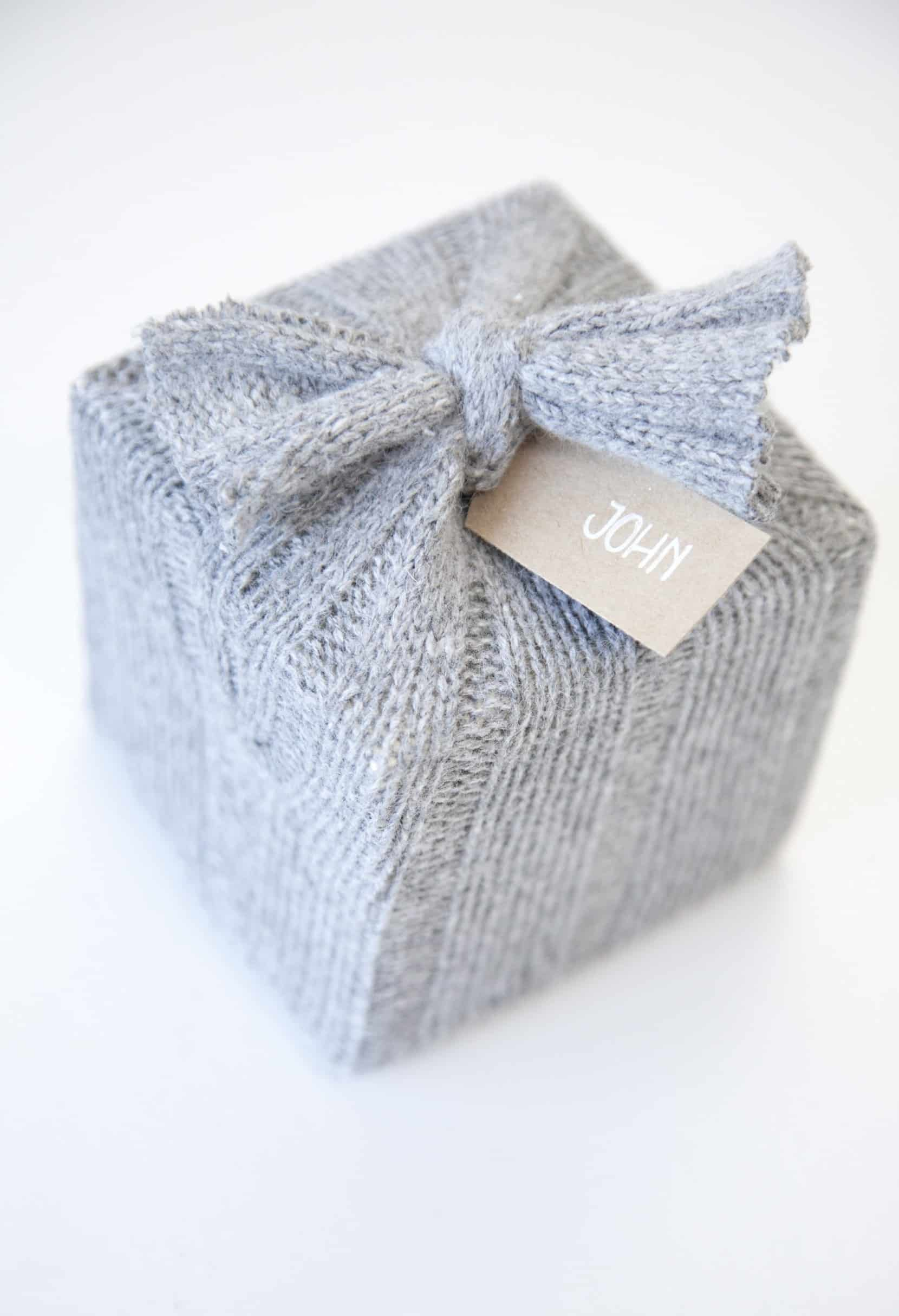 Cozy upcycled wool weater gift wrap