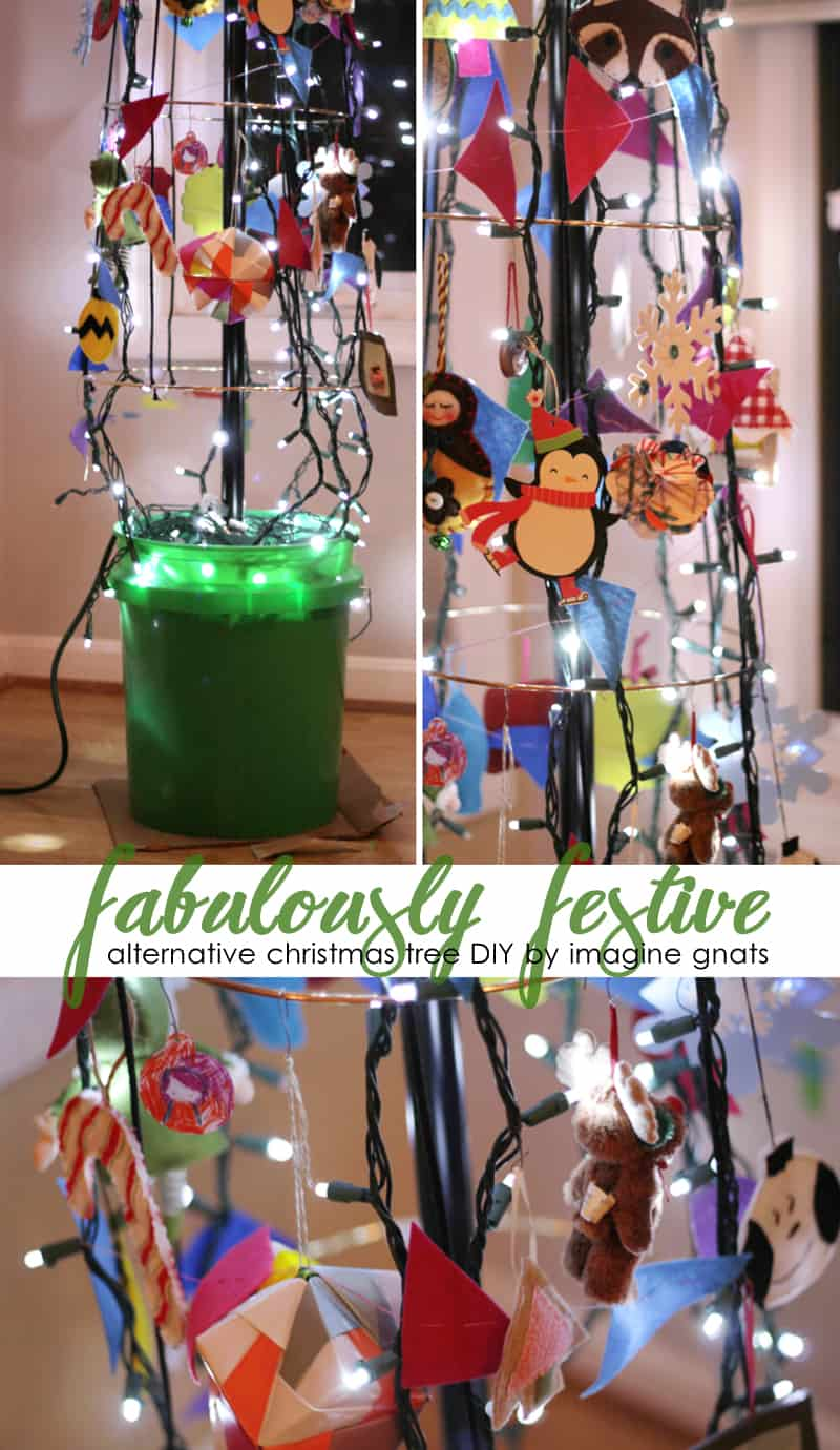 Festive lights and trinkets tree in a bucket 15 Homemade Alternative Christmas Trees That Are Striking