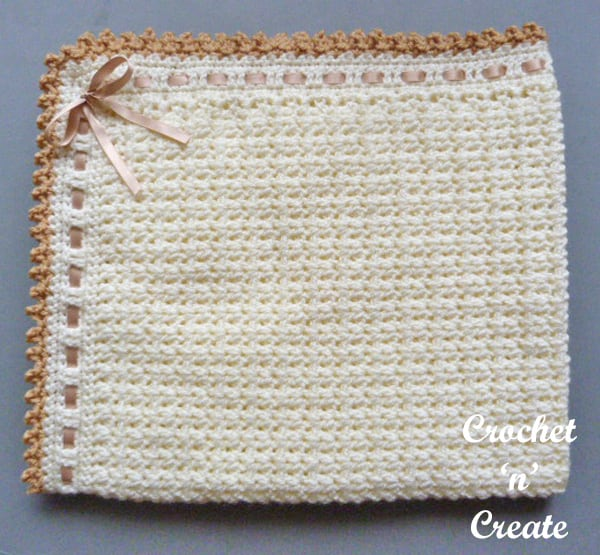 Free, pretty crocheted pram blanket with woven ribbon trim