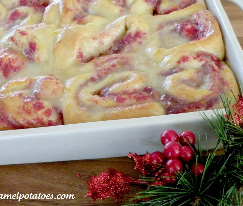 Glazed cranberry pecan orange rolls