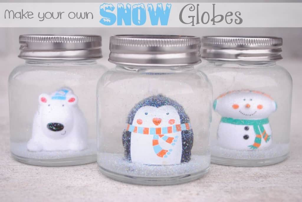 Mini jars and winter toy snow globes 15 DIY Snow Globes to Craft with Your Kids
