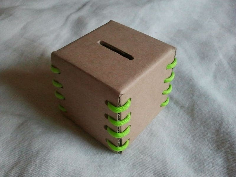 DIY cardboard coin bank 15 DIY Piggy Bank Ideas That Are Fun to Make