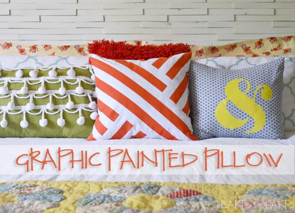 Graphic painted pillows using painter's tape